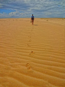 You do just walk in the sand, you wade :D